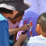 河野ルルちゃん|メキシコで壁画制作(距離の超近い子供達(笑))の写真