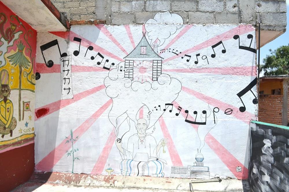 メキシコ・チアパス州サンクリストバルの日本人宿カサカサの壁画(スモーキング)の写真