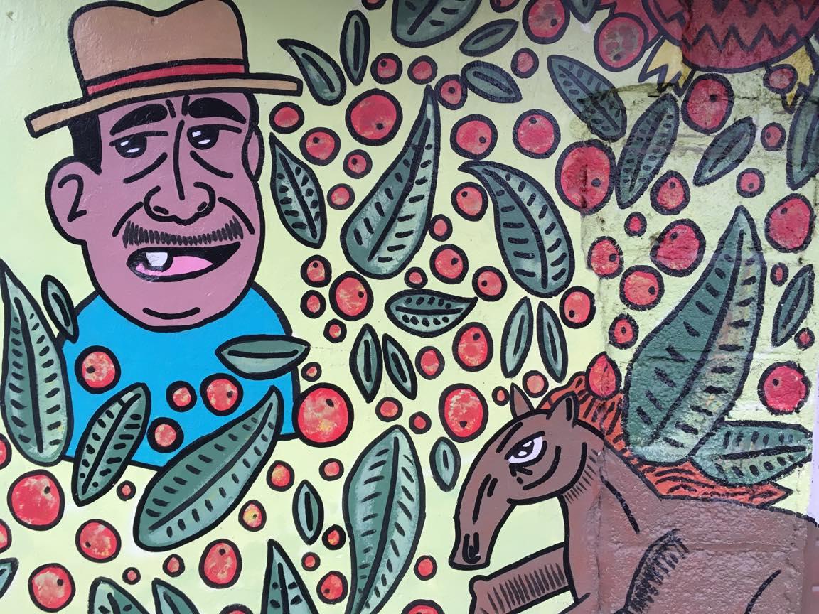 中米で見かけた壁画(馬とおっちゃん)の写真